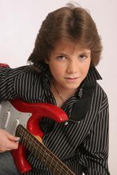 Jordan poses with guitar