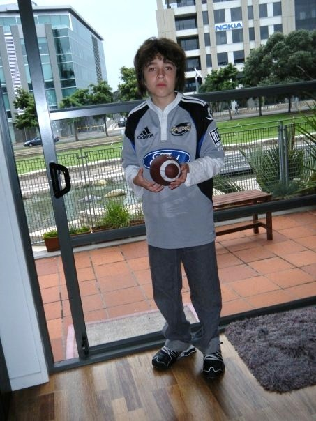 Sam holding his rugby ball