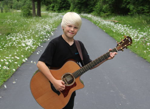 Carson Lueders With Guitar