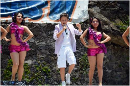Sebastián on stage with dancers
